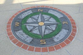 Concrete overlay with compass design